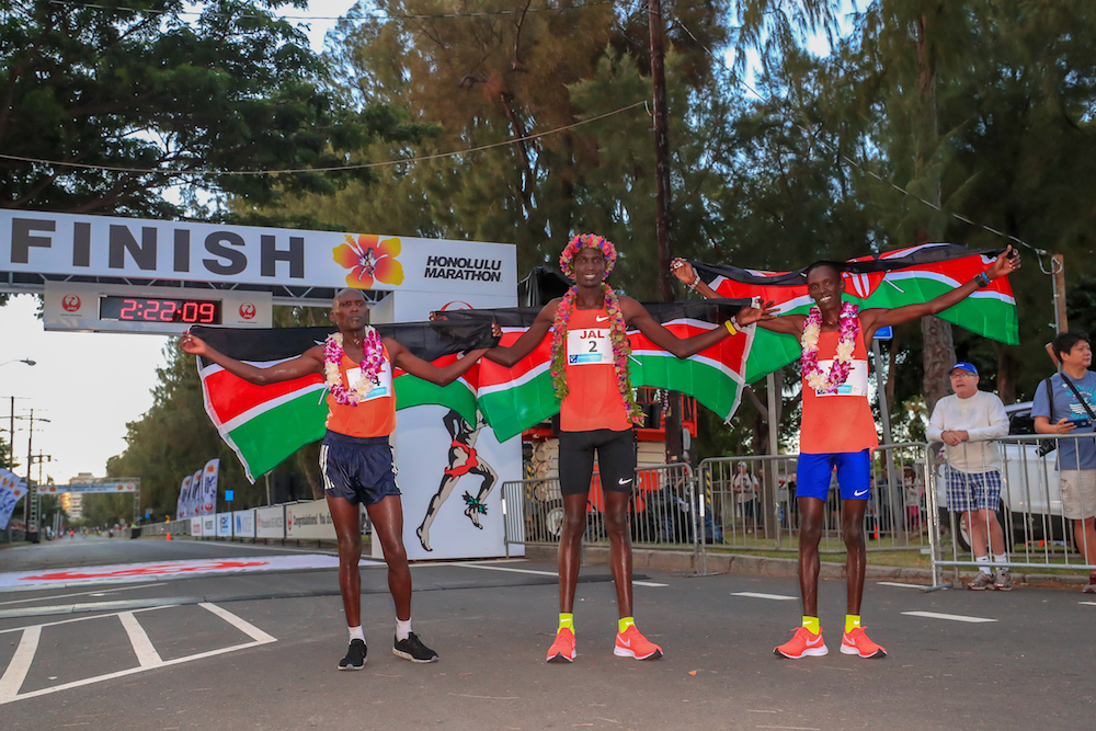 HONOLULU, HI - DECEMBER 09:  Three Kenyans finish 1st (Titus Ekiru: Center), 2nd (Reuben Kerio: Right), 3rd (Vincent Yator: Left) places during the Honolulu Marathon 2018 on December 9, 2018 in Honolulu, Hawaii.  (Photo by Tom Pennington/Getty Images for HONOLULU MARATHON) *** Local Caption *** Titus Ekiru; Reuben Kerio; Vincent Yator